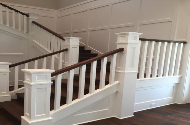 Custom Stairs, custom rail cap finish Pohl millwork.