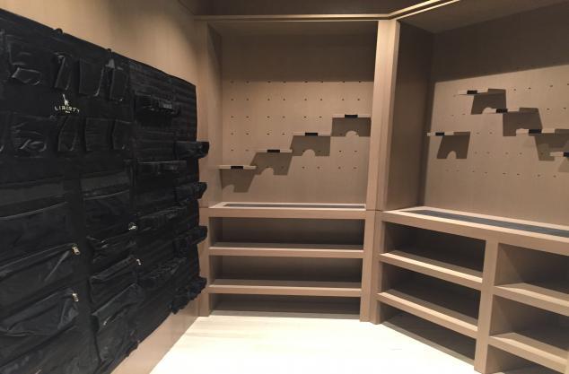 Custom wood gun room finished in rift oak with light glaze