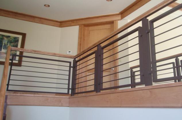 Custom millwork stained maple railings, trim, crown, basebaord