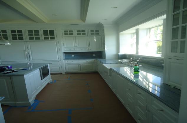 Custom finish on white raise panel kitchen